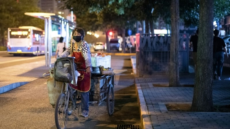 A Street Vendor Sells Fruit from a Tricycle in Beijing.afp - Copy