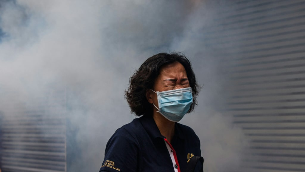 A Woman Reacts After a Police Fired Tear Gas.afp