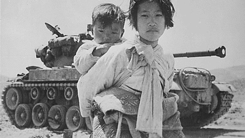A Young Girl with her Brother at Haengju, Korea in June 1951.afp
