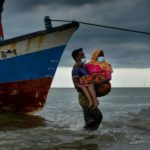 Stranded Rohingya Refugees Saved to Shore by Indonesian Fishermen