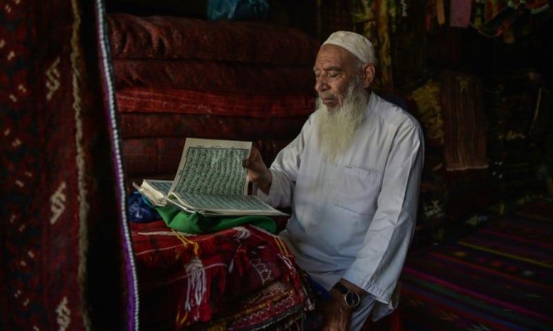 An Elderly Carpet Vendor in Kabul