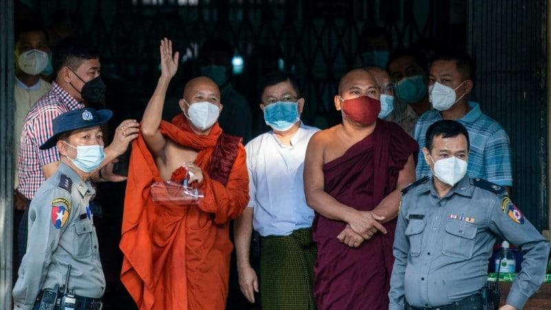 Ashin Wirathu waves to followers