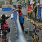 Virus-Hit Wuhan Waits for Barriers to Come Down