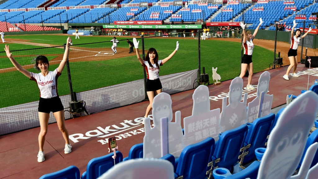 Cheerleaders Performs in Front of Cutout Fans.afp