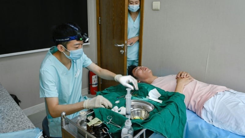 Chinese Men Undergoing Cosmetic Treatment