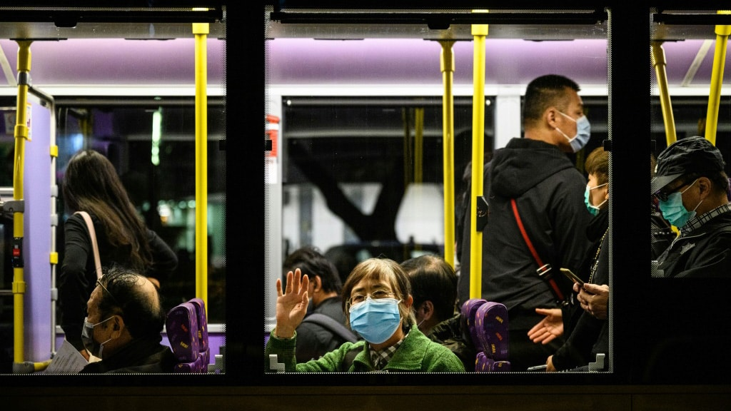 Commuters Across Hong Kong Border to Mainland China.afp