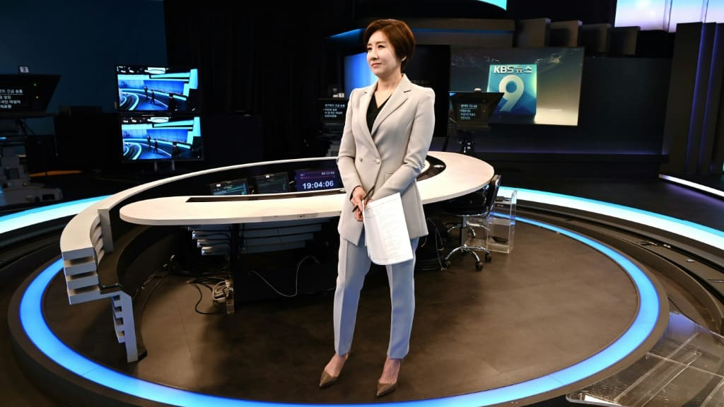 Female Korean News Anchor.afp