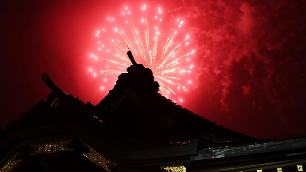 Fireworks Over the Ookunitama Jinja shinto Shrine in Tokyo.afp