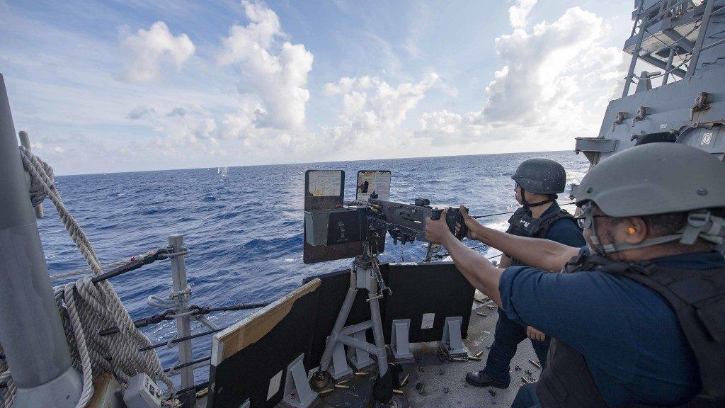 Gunner's Mate Seaman Caliph Proctor, from Fayatteville, N.C., shoots a .50-caliber machine gun aboard the Arleigh Burke-class guided-missile destroyer USS McCampbell - Naval Surface Warriors