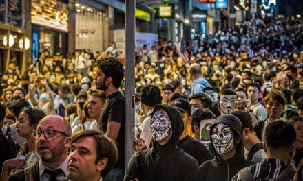 Thousands Defy Mask Ban at Hong Kong Halloween Showdown
