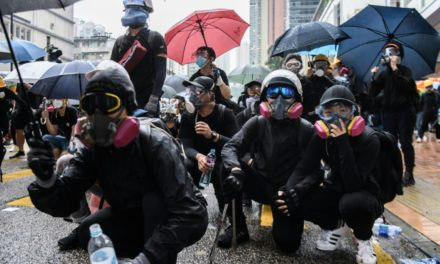 Hong Kong: Shot Protester Charged, as Gov Moves to 'Ban Face Masks'