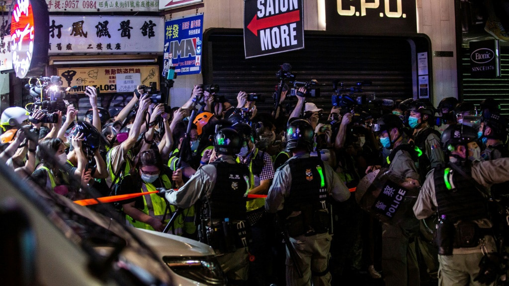 Hong Kong Police Hold Back Reporters.afp