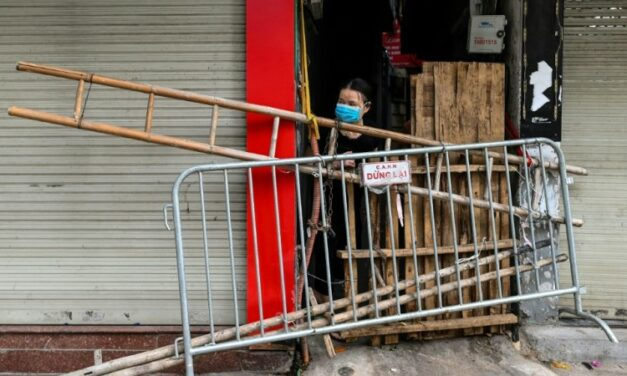 Beer Crates and Broken Chairs: Barricades Divide up Locked-Down Hanoi