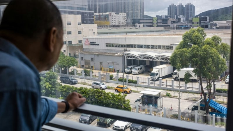 Jimmy Lai Looks Out of His Office Window.afp