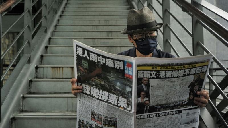 Kacey Wong reading a newspaper