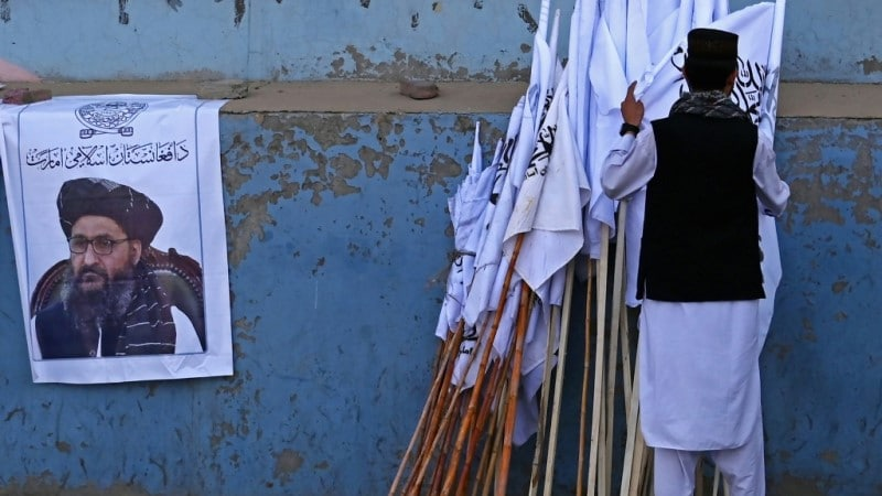 Man with Taliban poster