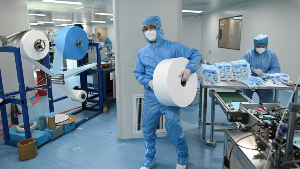 Mask Making at Naton Medical Group in Beijing.afp