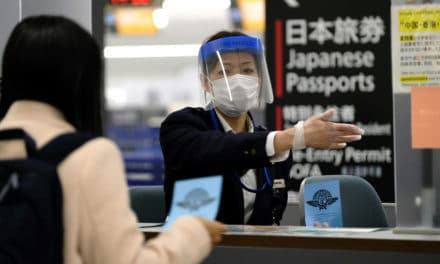 Japan Politician Apologizes for $87,000 Masks Price Gouging Auction