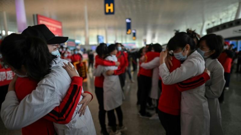 Medical Staff Hug Nurses in Wuhan in April 2020
