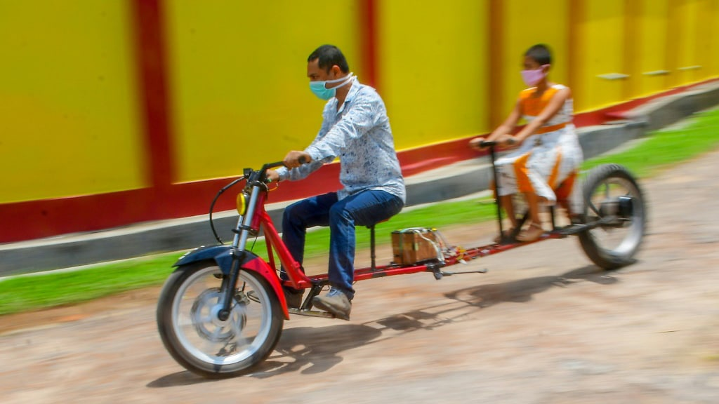Motorbike Designed for Social Distancing in India.afp