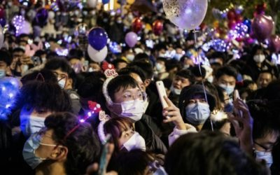 Crowds Throng Wuhan, Where Pandemic Began, to Celebrate New Year