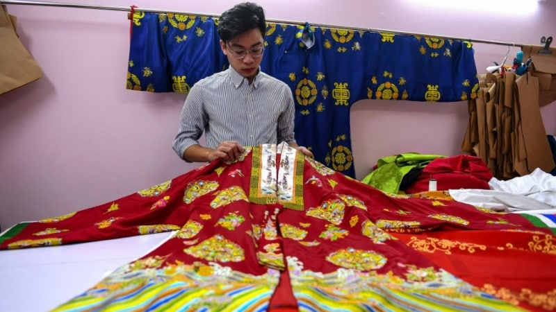 Nguyen Duc Loc Checking an Outfit