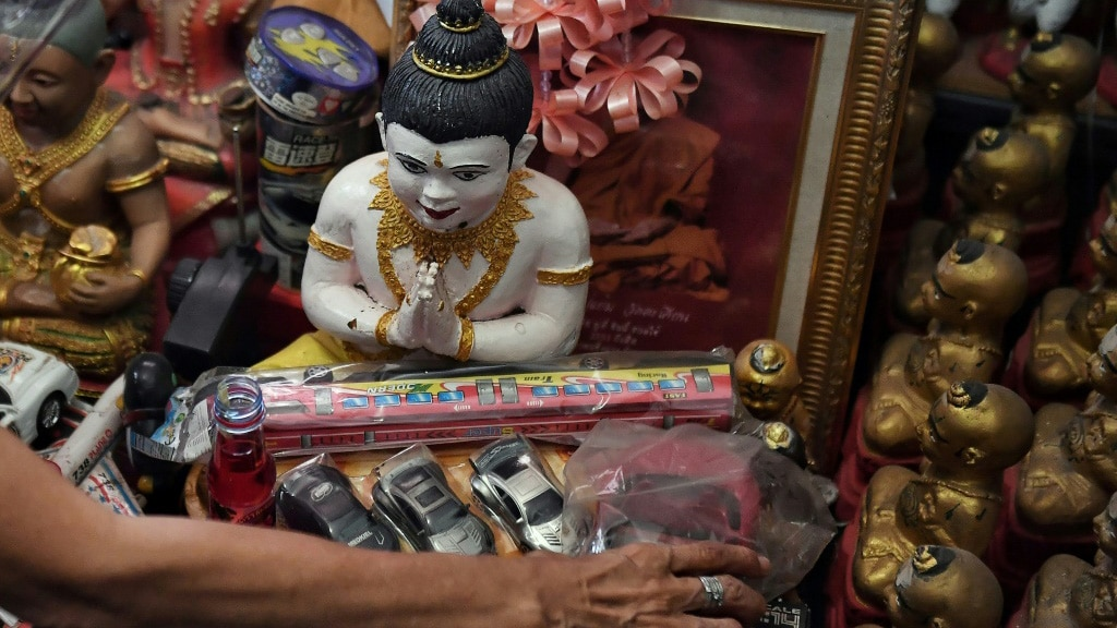 Offerings to the Golden Son Dolls in Thailand.afp