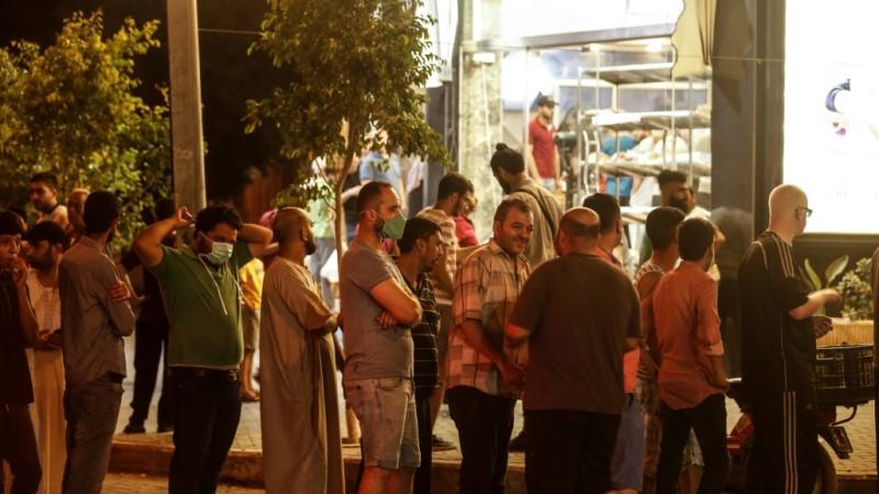 People Queue in Gaza City
