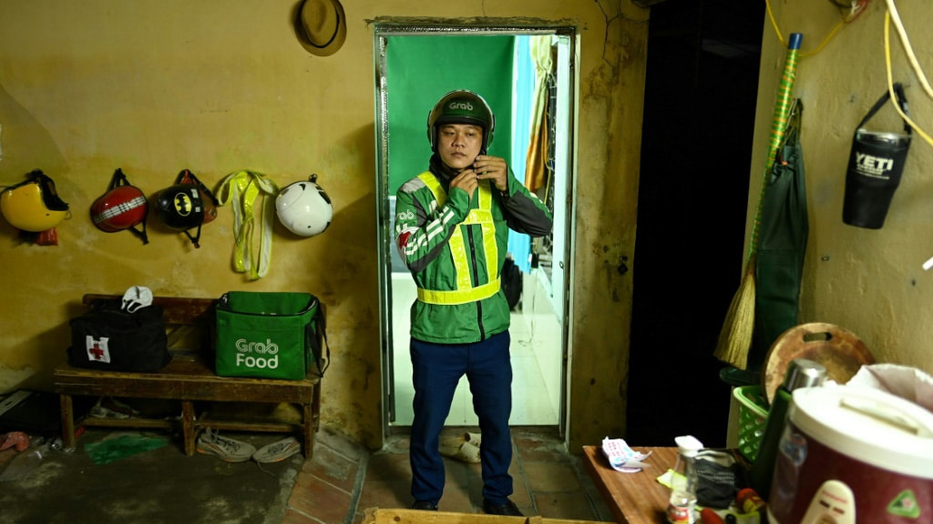 Pham Quoc Viet Works for Grab by Day and by Night an Unofficial Emergency Responder.afp