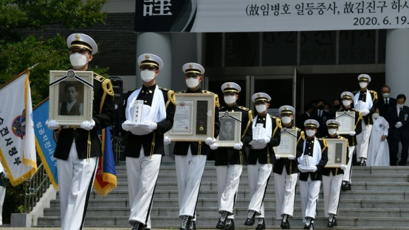 Portraits and Urns of Compatriot Soldiers Killed During the Korean War.afp