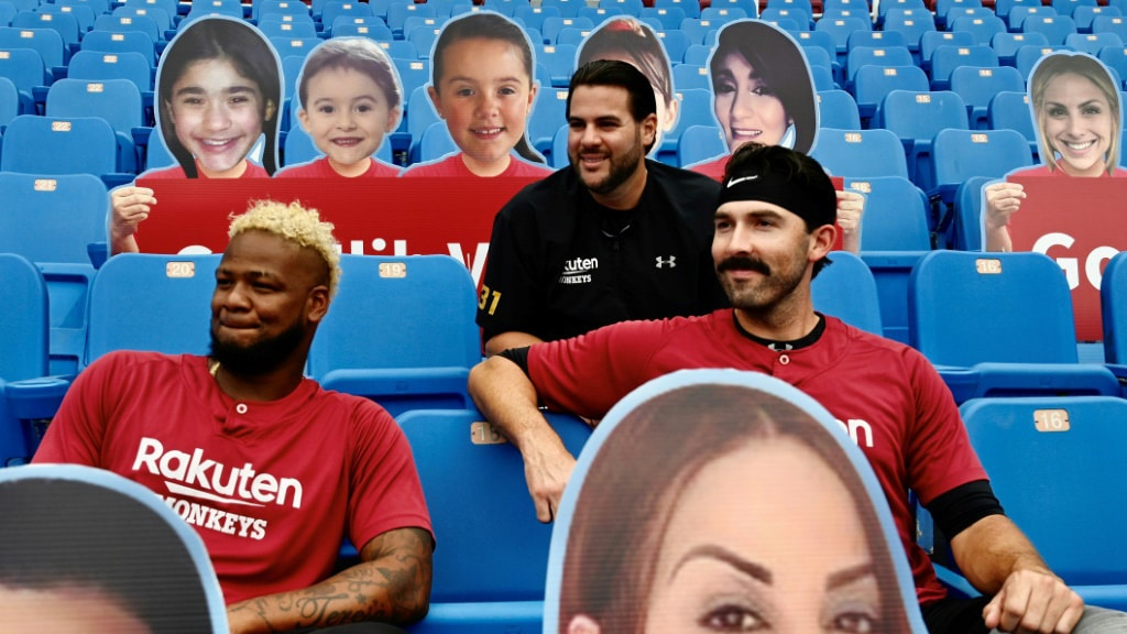 Rakuten Monkeys Players Sit Among Cutout Fans.afp