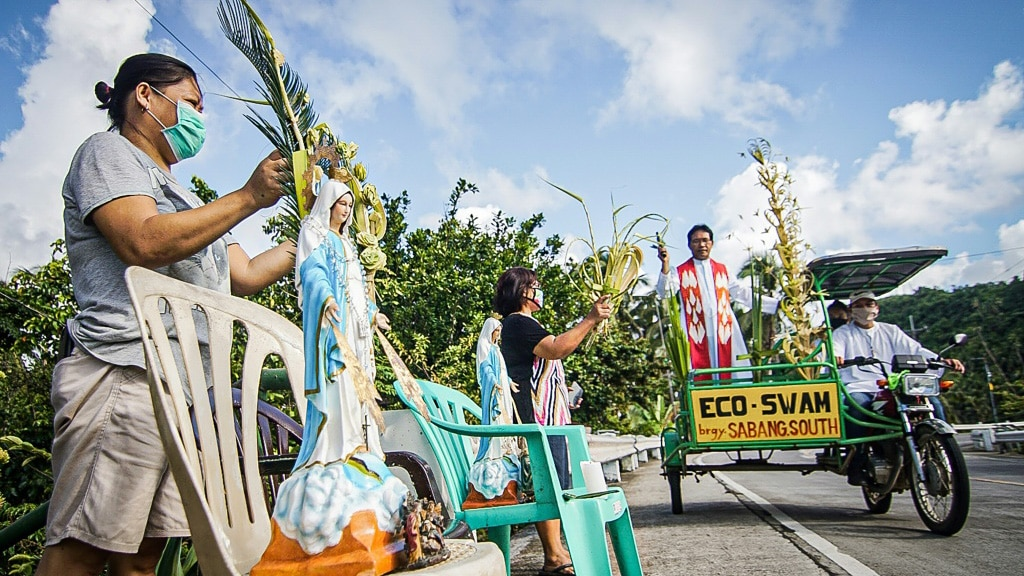 Roman Catholic Priest Delivers Blessing in Borongan Philippines.afp