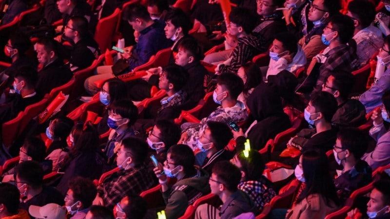Spectators Wear Mask