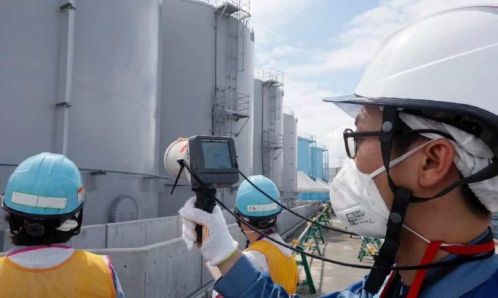 Staff measure Radiation Levels ©AFP