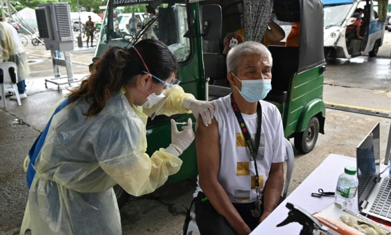 Taxi Driver Vaccinated in Manila