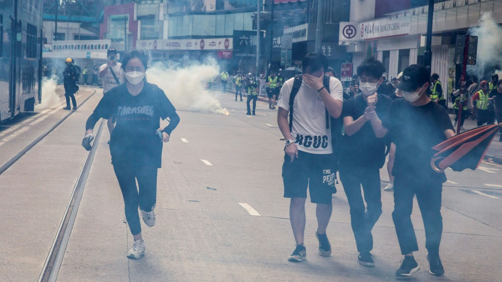 Tear Gas and Pepper Spray to Try and Disperse the Crowd.afp