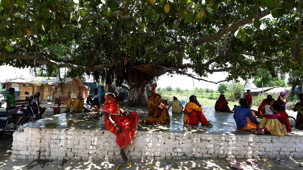 Tree Shade an Escape from the Heat for Some Residents in India.afp