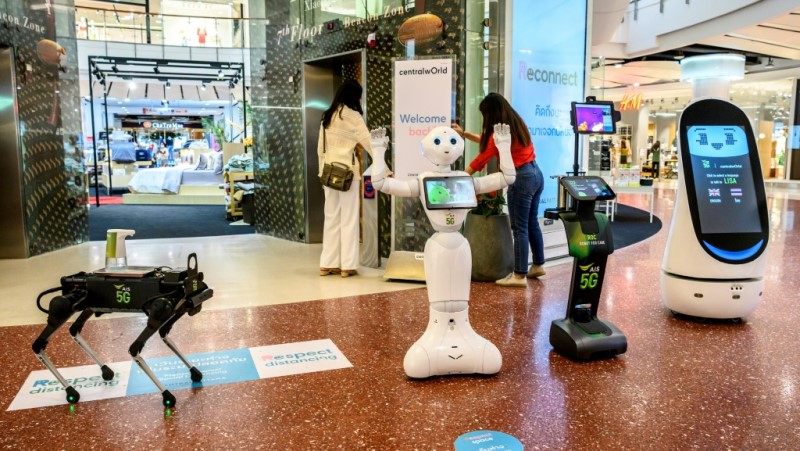 Various Robotic Devices Teach People About Coronavirus Precautions.afp