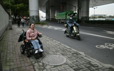 China Wheelchair Users Dodge Traffic on Rough Road to Recognition