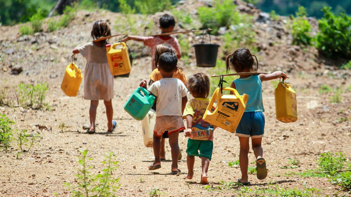 Children walk to nearby river for water Supply - Laos