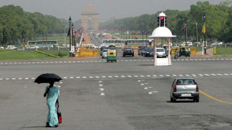 Woman with Umbrella in New Delhi.afp