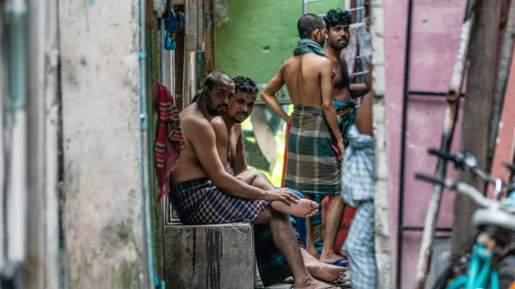 Workers Gather in an Alleyway in Male Maldives.afp